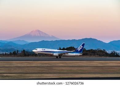SHIZUOKA, JAPAN - JAN. 5, 2019: ANA Boeing 737-800 taking off from the Shizuoka International Airport in Shizuoka,Japan at dusk.