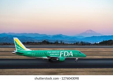 SHIZUOKA, JAPAN - JAN. 5, 2019: FDA (Fuji Dream Airlines) Embraer ERJ-170-100 taxing at the Shizuoka International Airport in Shizuoka, Japan at dusk.
