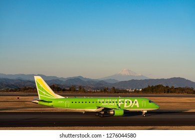 SHIZUOKA, JAPAN - JAN. 5, 2019: FDA (Fuji Dream Airlines) Embraer ERJ-170-200 taxing at the Shizuoka International Airport in Shizuoka, Japan at dusk.