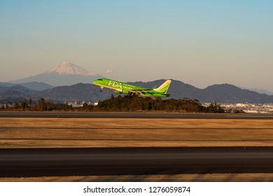 SHIZUOKA, JAPAN - JAN. 5, 2019: FDA (Fuji Dream Airlines) Embraer ERJ-170-200 taking off from the Shizuoka International Airport in Shizuoka, Japan at dusk.