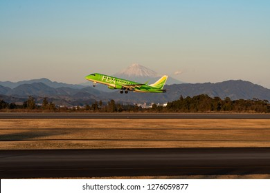 SHIZUOKA, JAPAN - JAN. 5, 2019: FDA (Fuji Dream Airlines) Embraer ERJ-170-200 taking off from the Shizuoka International Airport in Shizuoka, Japan at dusk.