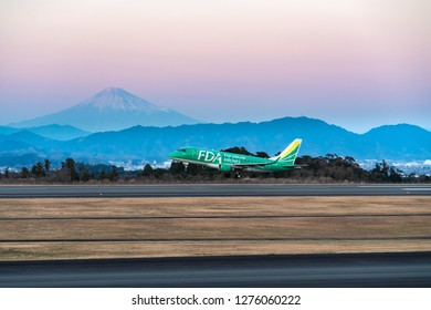 SHIZUOKA, JAPAN - JAN. 5, 2019: FDA (Fuji Dream Airlines) Embraer ERJ-170-100 taking off from the Shizuoka International Airport in Shizuoka, Japan at dusk.