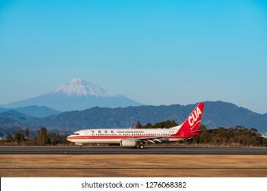 SHIZUOKA, JAPAN - JAN. 5, 2019: China United Airlines Boeing 737-800 landing the Shizuoka International Airport in Shizuoka, Japan.