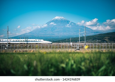 Shizuoka, Japan, November 02, 2018:  Mt. Fuji with Shinkansen train and rice field at Shizuoka, Japan.