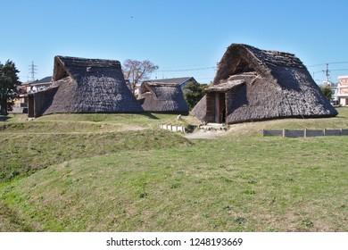 Shizuoka, Japan - November 2018: Recreated Japanese neolithic Yayoi period village and dwellings at  the Toro Ruins archaeological site and museum in Shizuoka, Japan.