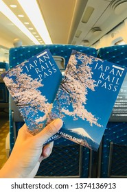 Shizuoka, Japan-October 22, 2018. Japan rail pass holding in woman's hand. Japan rail pass is ticket for tourist only. This pass use for Shinkansen, train, Ferry to Miyajima and some bus by JR company