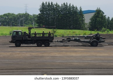 Shizuoka,Japan - July 10, 2011:Japan Ground Self-Defense Force Artillery tractor with FH-70 155mm towed howitzer.
