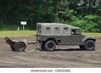 Shizuoka,Japan - July 10, 2011:Japan Ground Self-Defense Force Toyota High Mobility Vehicle (HMV) with Mortier 120mm towed mortar RT.