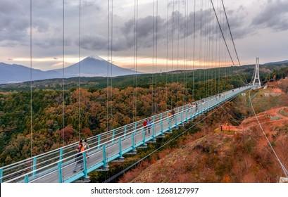 Shizuoka,Japan-November 16,2018; Mishima SkyWalk with Mountain Fuji in background in  Autumn. Mishima Sky Walk is new tourist spot in Mishima Shizuoka Prefecture Japan.