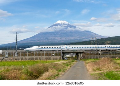 SHIZUOKA,JAPAN-November 16,2018; Shinkansen with  Mountain Fuji in background.The famous view of Mount Fuji in combination with shinkansen trains can be enjoyed from the farmland east of Fuji City.