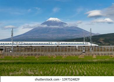 SHIZUOKA,JAPAN-November 16,2018; Shinkansen with  Mountain Fuji in background.The famous view of Mount Fuji in combination with shinkansen trains can be enjoyed from the farmland east of Fuji City.