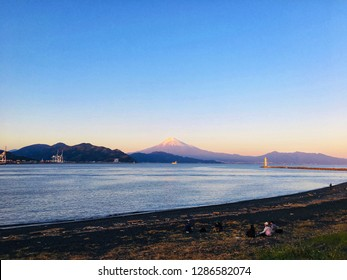 Shizuoka,Japan-October 21,2018. Fuji mountain and Miho beach among sunset.Miho beach has black sand and one of famous place in Shizuoka for relax with Fuji view.Lots of family look at Fuji.Blur photo.
