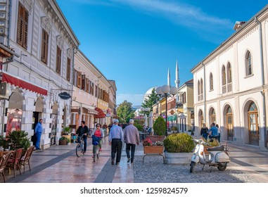 SHKODER, ALBANIA - June 14, 2019 - cityscape and street view of the central street in northern Albanian city of Shkodra. Unknown tourists walk along pedestrian street (Rruga Kole Idromeno)
