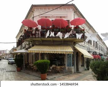 Shkoder, Albania - June 22, 2019. Cafe FLO in Kole Idromeno pedestrian street.