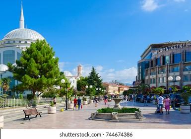 SHKODER, ALBANIA - SEPTEMBER 6, 2017: Unknown people walk along pedestrian street (Rruga Kole Idromeno). Abu Bekr Mosque (Xhamia e Madhe), Hotel Colosseo, Shkoder, Albania