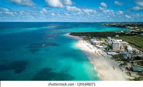 Shoal Bay Beach Anguilla Caribbean, tropical holiday. Turquoise ocean and beautiful landscape with white sand. Hotels and restaurant view from a drone perspective