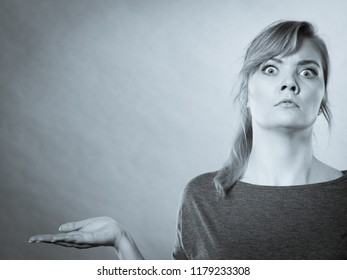 Shock and disbelief concept. Surprised astonished girl with wide open mouth. Amazed female looking very shocked. Facial expression and body language.