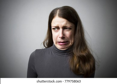 Shock in a woman. Disgust. A woman expresses an emotion of rejection.