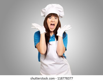 Shock To Woman On Cooking Time On Gray Background