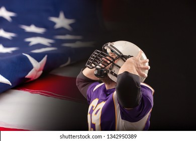Shocked American Football Player looking up to the score with US flag on background