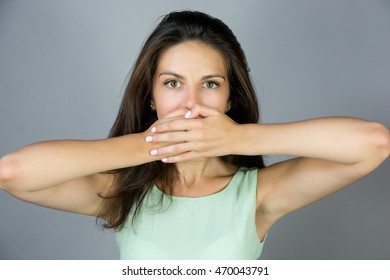 shocked beautiful girl covering her mouth with hands