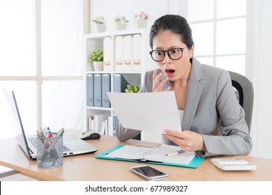 shocked beauty girl business manager received layoff message letter from company feeling surprised.