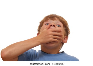Shocked boy covers his mouth with his hand