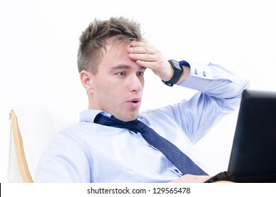An shocked business man looking at his monitor