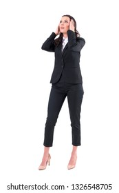 Shocked business woman with head in hands looking up in despair. Full body isolated on white background.