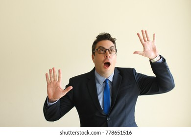 Shocked businessman gesturing like touching glass