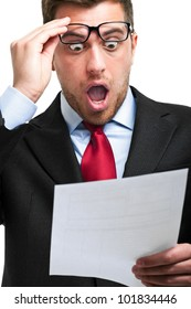 Shocked businessman isolated on white while reading an expensive bill