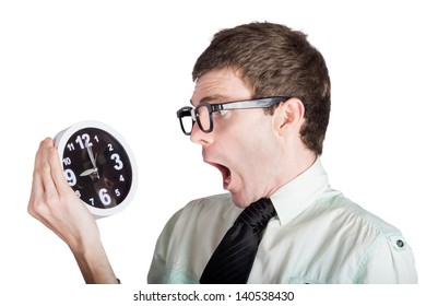 Shocked businessman looking at retro alarm clock, overdue concept on white background
