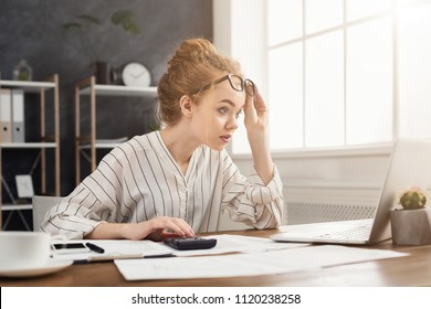 Shocked businesswoman amazed by reading online breaking news on laptop, looking at strange test results on computer screen, copy space