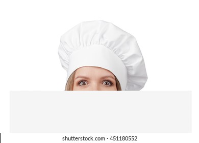 shocked chef, cook or baker woman eyes peeking over edge of banner with empty copy space for you text isolated on white background. advertisement blank board. your text here
