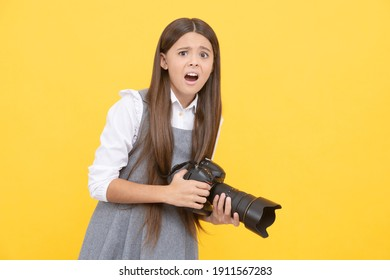 shocked child girl take photo with digicam, photography.