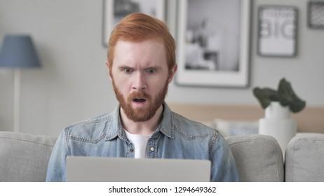 Shocked Creative Beard Man Working on Laptop, Astonished