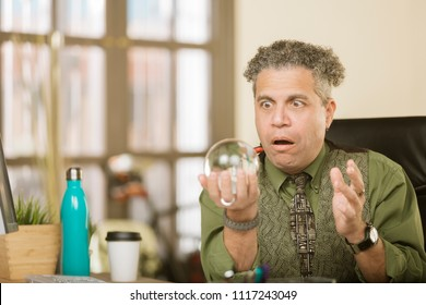 Shocked creative professional man with a crystal ball
