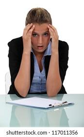 Shocked employee sitting at her desk