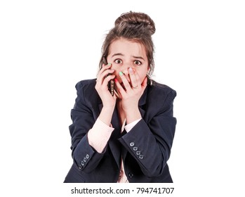 Shocked executive director of a young woman, dressed in black elegant clothes, surprised by information during a telephone conversation
