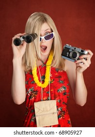 Shocked Female Tourist with Camera and Binocular in her hands