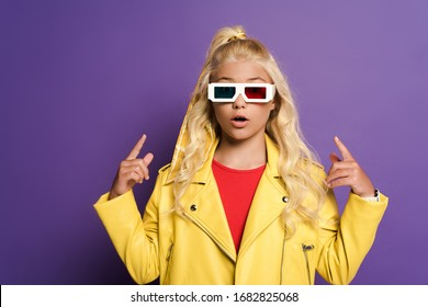 shocked kid with 3d glasses pointing with fingers on purple background