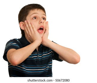A shocked kid is holding his hands at his face; isolated on the white background