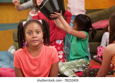Shocked little African-American kid at a sleepover