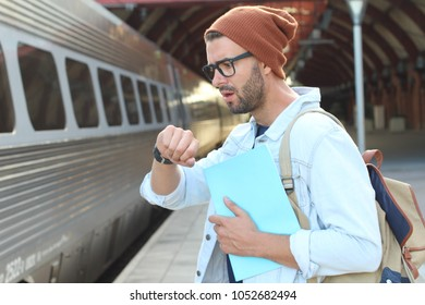 Shocked male after checking the time at the train station