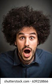 Shocked Man with Afro Hair