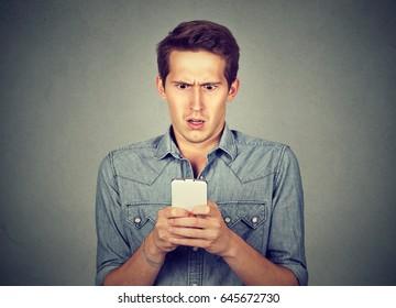 Shocked man checking his mobile phone