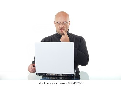 Shocked man working with his laptop isolated over white