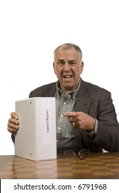 shocked older businessman with annual report isolated on white