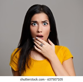 Shocked scared woman isolated