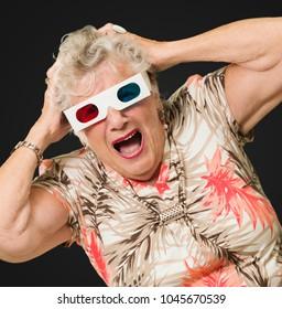 Shocked Senior Woman Watching 3d Movie On Black Background